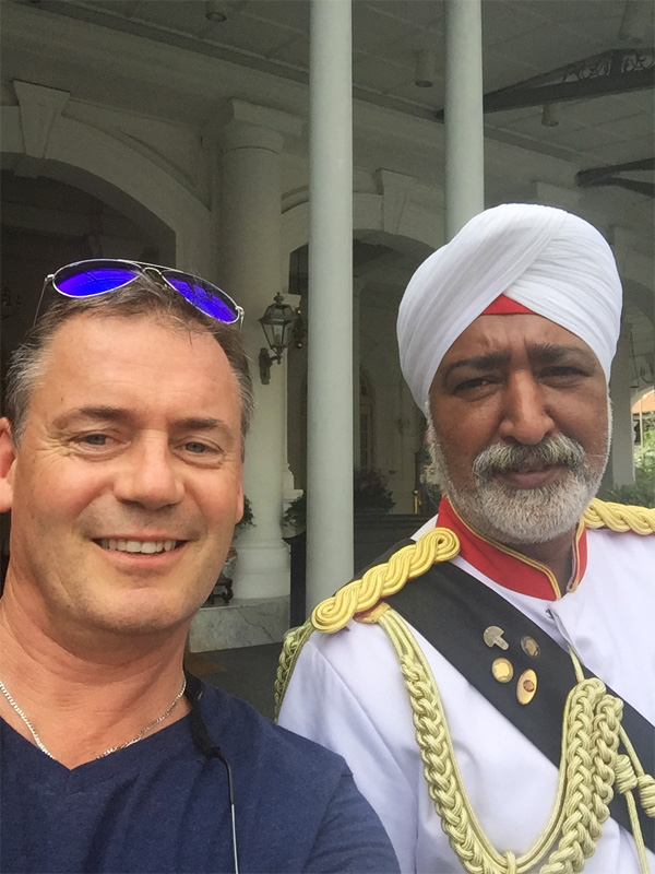 RAFFLES HOTEL Singapore doorman and the walking critic
