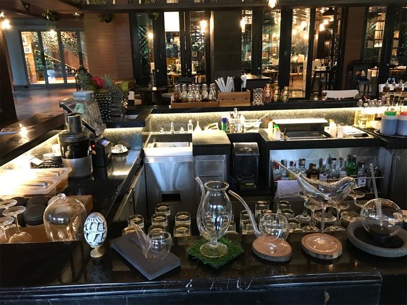 HOTEL INDIGO BALI REVIEW Tree Bar bottles