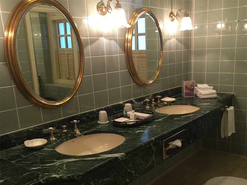 Raffles Hotel Singapore bathroom with green marble