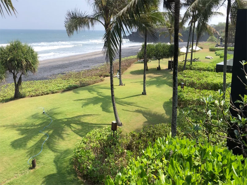 SOORI Bali view from villa across the manicured lawns